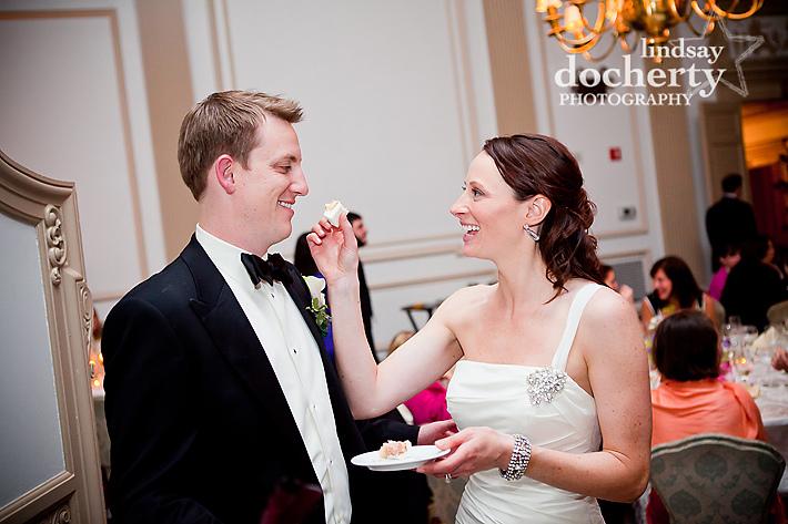 bride and groom feeding wedding cake