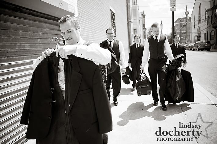 groom and groomsmen walk to Philadelphia church