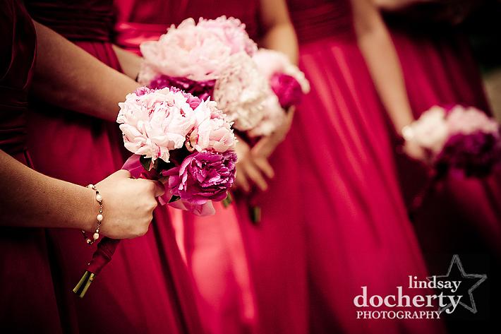 bridesmaids holding wedding flowers