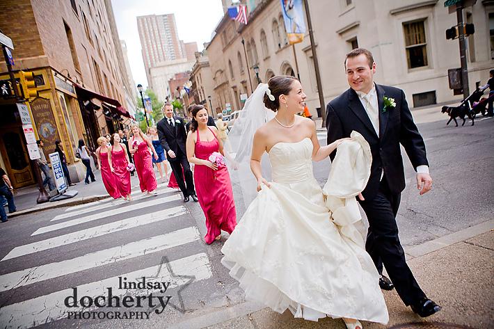bridal party walks into Rittenhouse Square