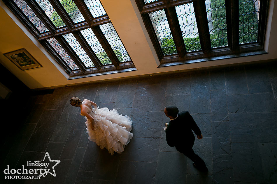 Bride and groom in Aldie Mansion with windows