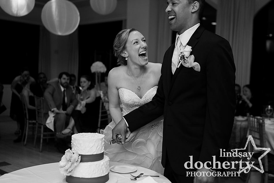Couple cutting the wedding cake at Aldie Mansion