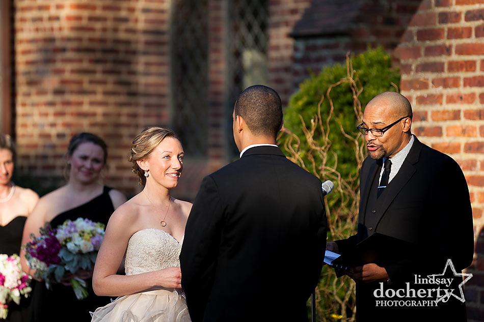 Interracial couple ceremony at Aldie Mansion