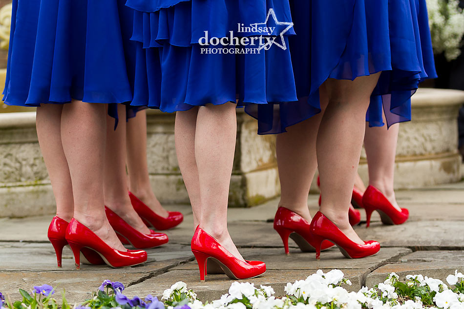 Bridesmaids in navy blue with red patent leather heels