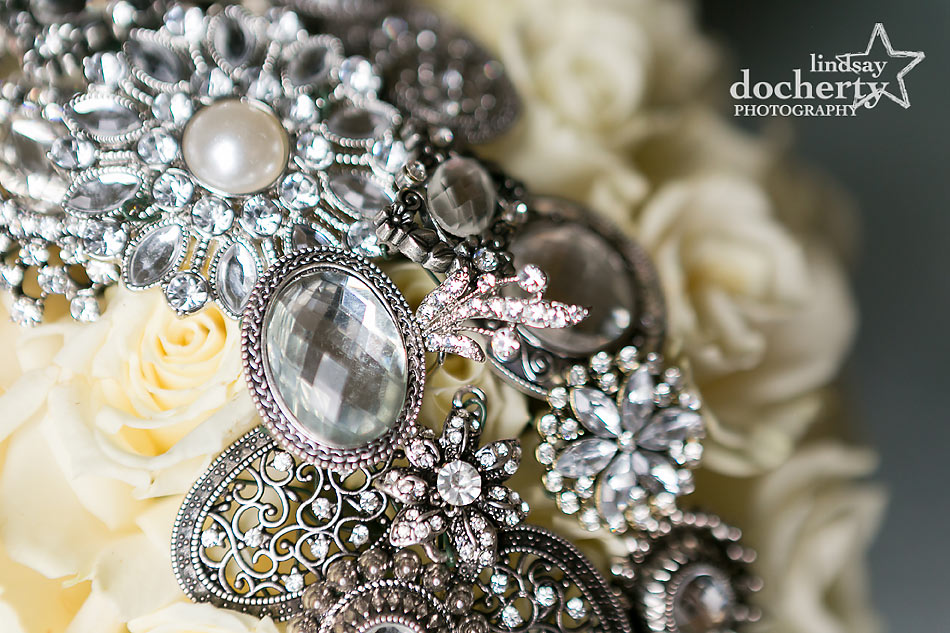 sparkly brooches in bridal bouquet
