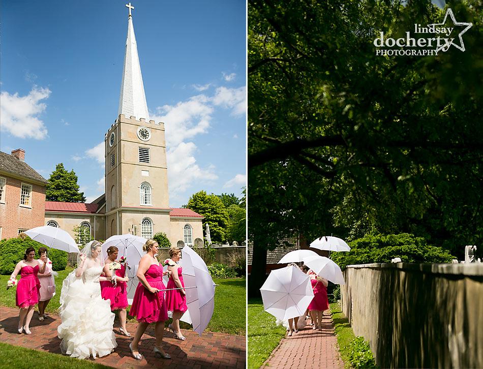Bride and bridesmaids with umbrellas  May wedding at Immanuel Episcopal Church in Newark Delaware