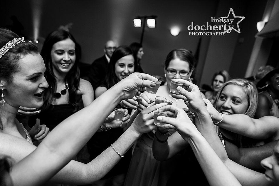 bride and bridesmaids taking shots at Delaware wedding reception
