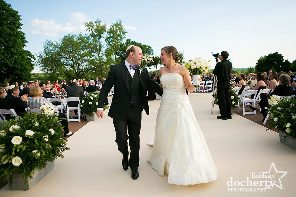 Bride and groom wedding recessional at ACE Conference Center in Lafayette Hill