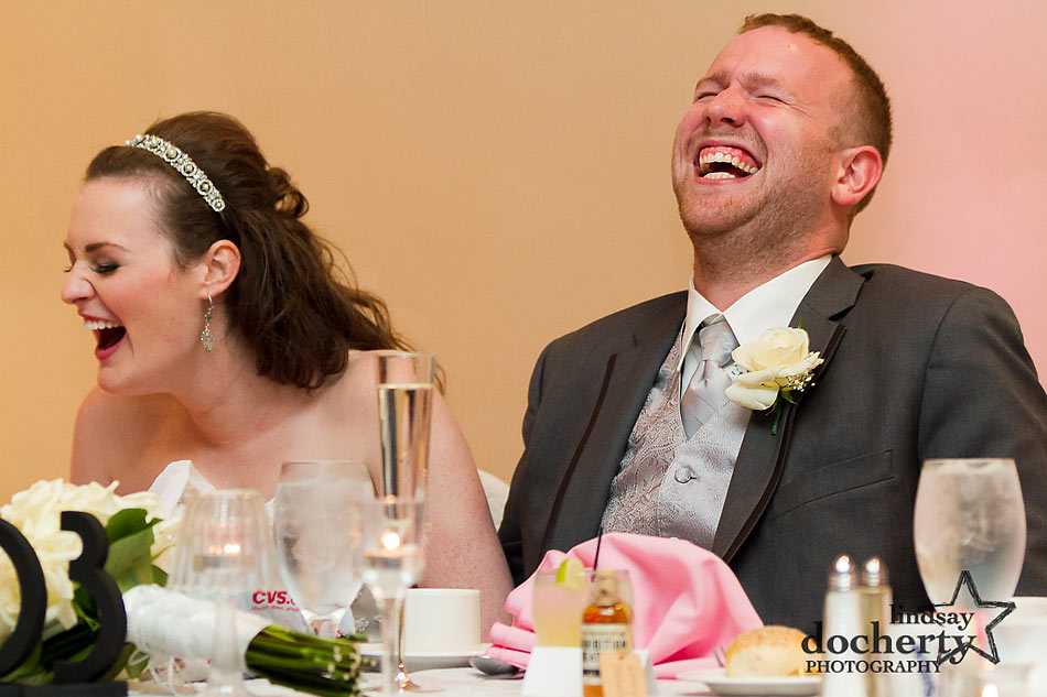 bride and groom laughing during Delaware wedding reception