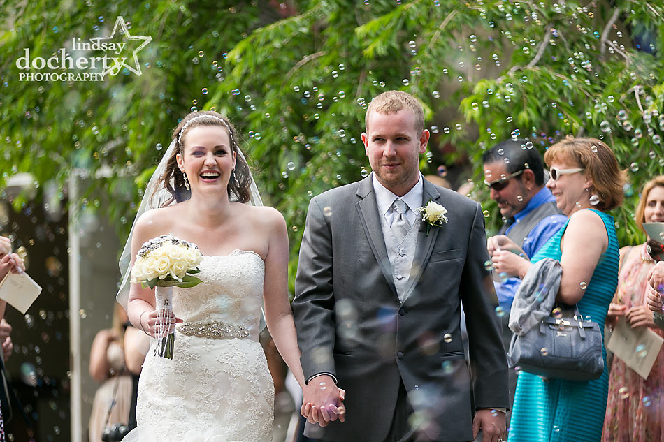 Bride and groom leaving ceremony to bubble exit at Immanuel Episcopal Church in Newark Delaware
