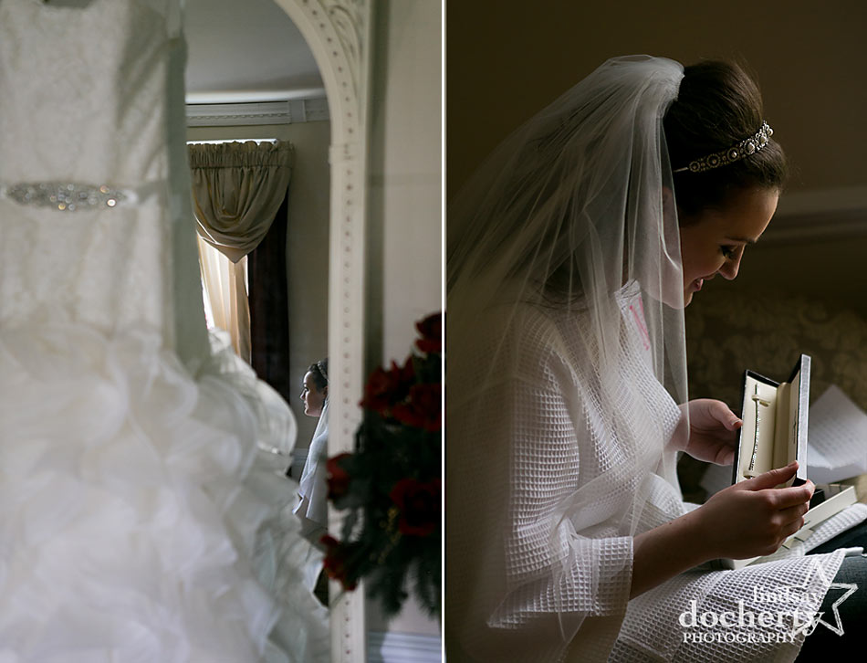 bride getting ready with dress and groom gift