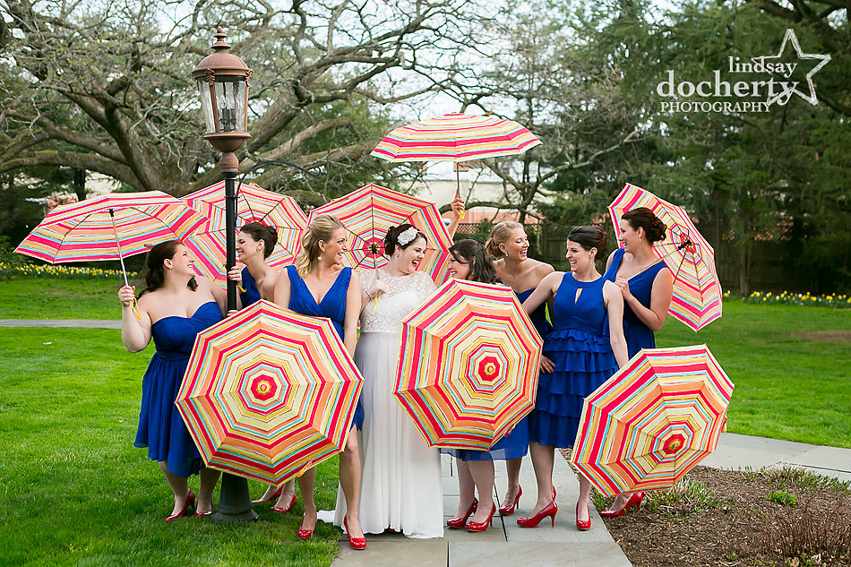 Bridesmaids at Aldie Mansion with umbrellas