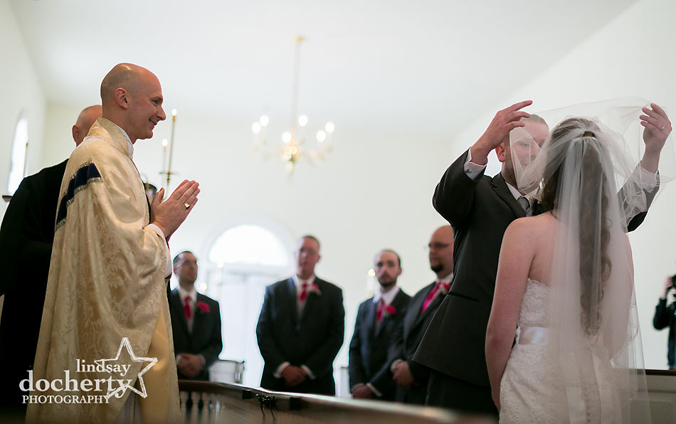 first kiss at wedding ceremony at Immanuel Episcopal Church in Newark Delaware