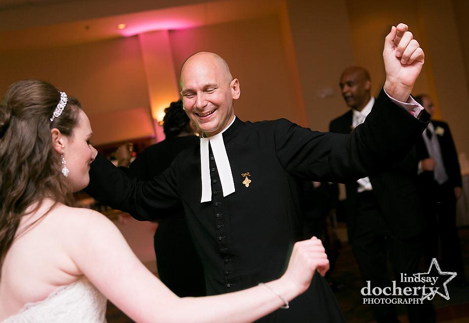 priest dancing during Delaware wedding reception