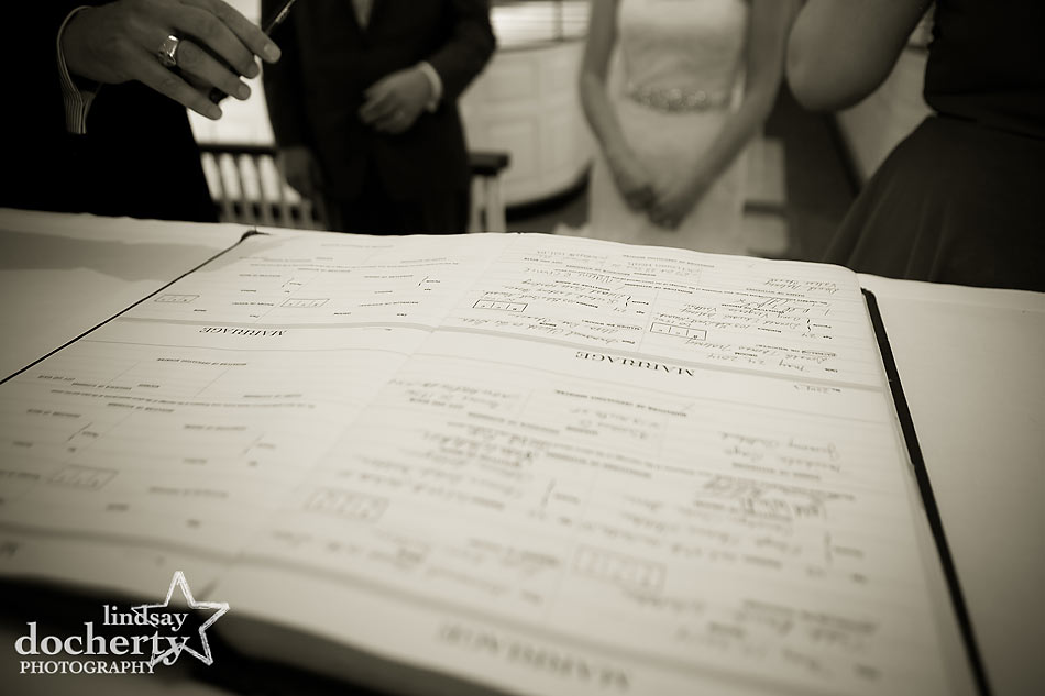 signing marriage license after Wedding ceremony at Immanuel Episcopal Church in Newark Delaware