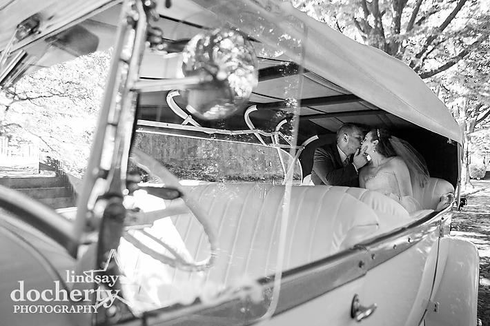 Delaware wedding couple in vintage limo