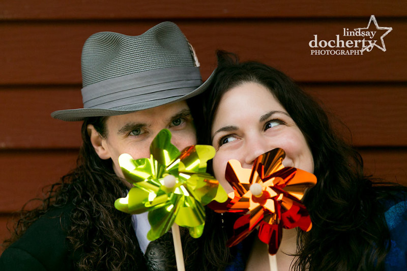 New Jersey engagement pictures with offbeat couple and hat and pinwheel