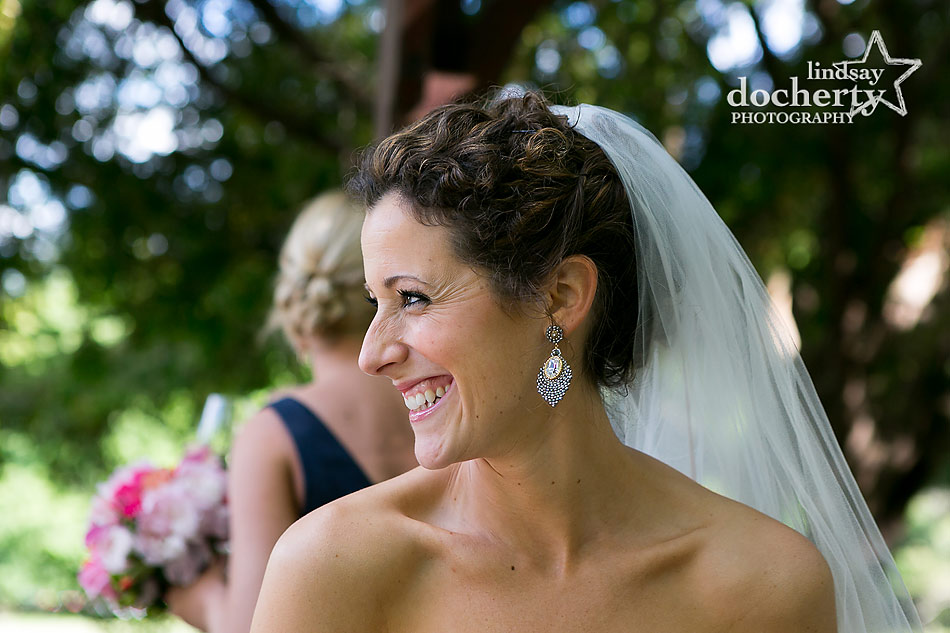 Short curly hair bride with veil on wedding day