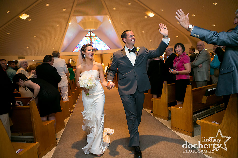bride and groom wedding recessional at St. Ignatius Loyola Church
