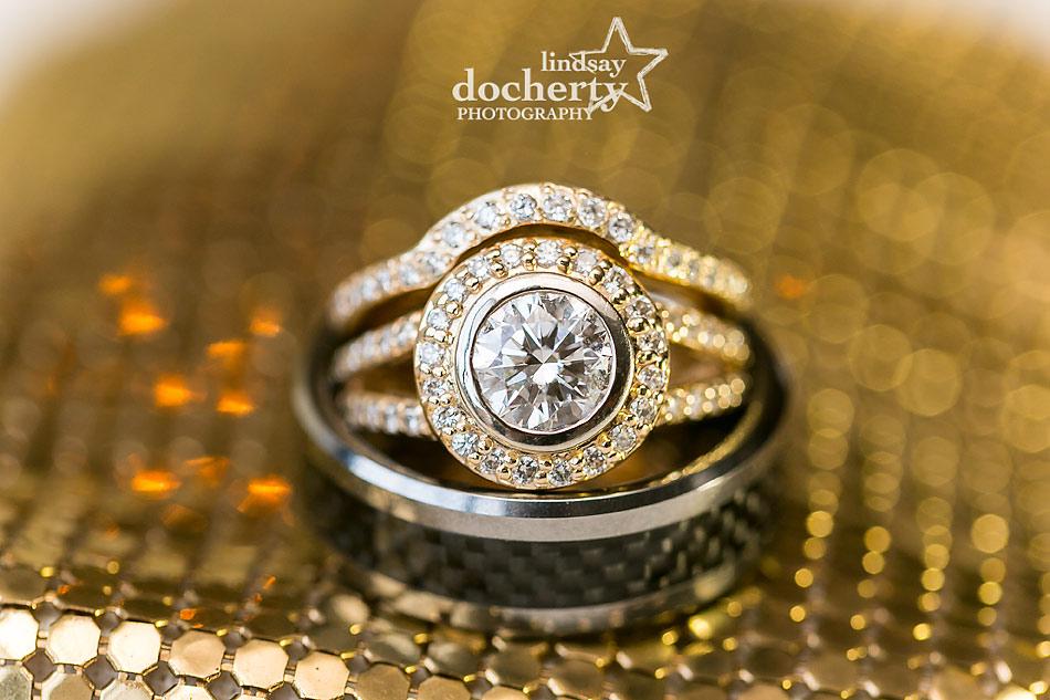 big gold wedding and engagement ring macro shot