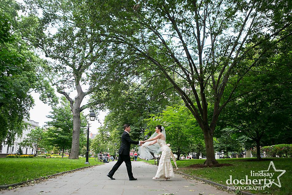 bride and groom dancing on wedding day in Philadelphia Washington Square Park