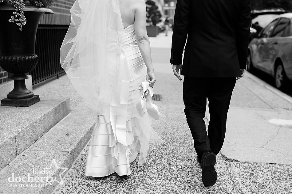 bride and groom shoes on wedding day in Philadelphia Washington Square Park