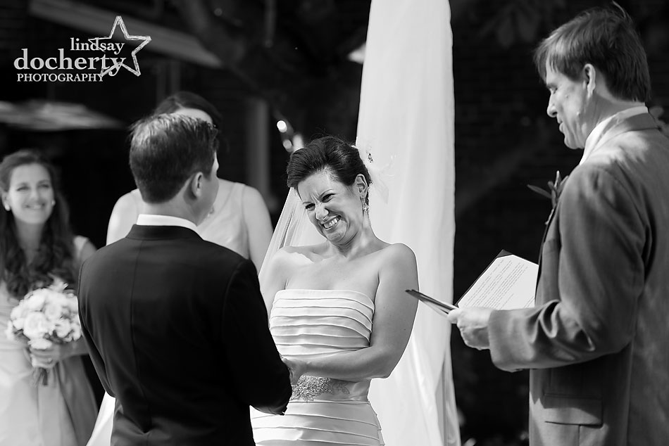 bride and groom during wedding ceremony vows at Morris House Hotel in Philadelphia