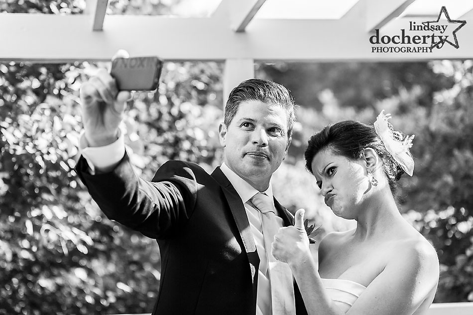 bride and groom funny selfie on wedding day