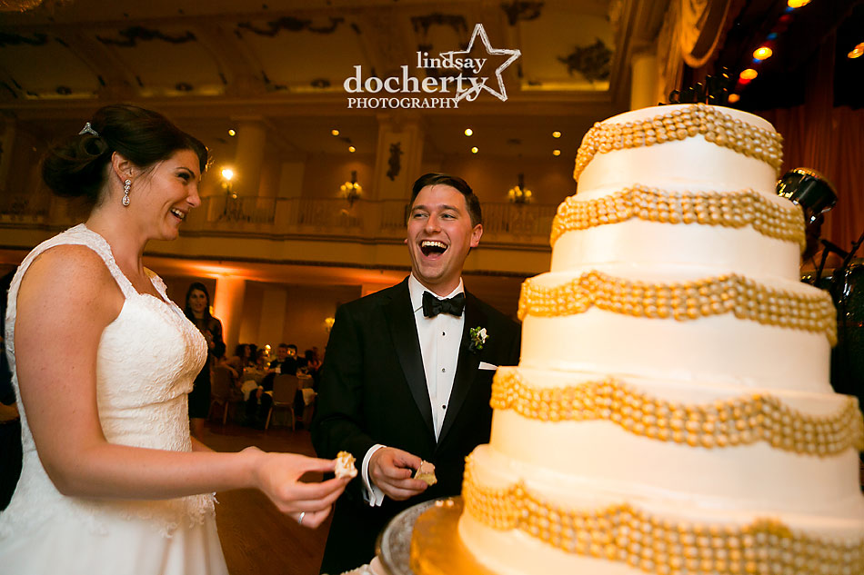 cake cutting at Philadelphia wedding reception at the Hyatt at the Bellevue grand ballroom