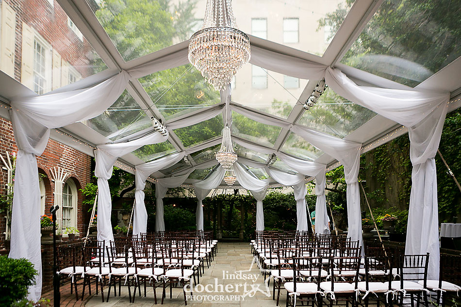 outdoor wedding ceremony at Morris House Hotel in Philadelphia with draped and tent