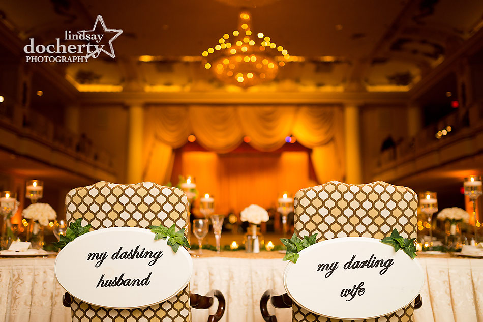 cute bride and groom chair signs at Philadelphia wedding reception at the Hyatt at the Bellevue grand ballroom