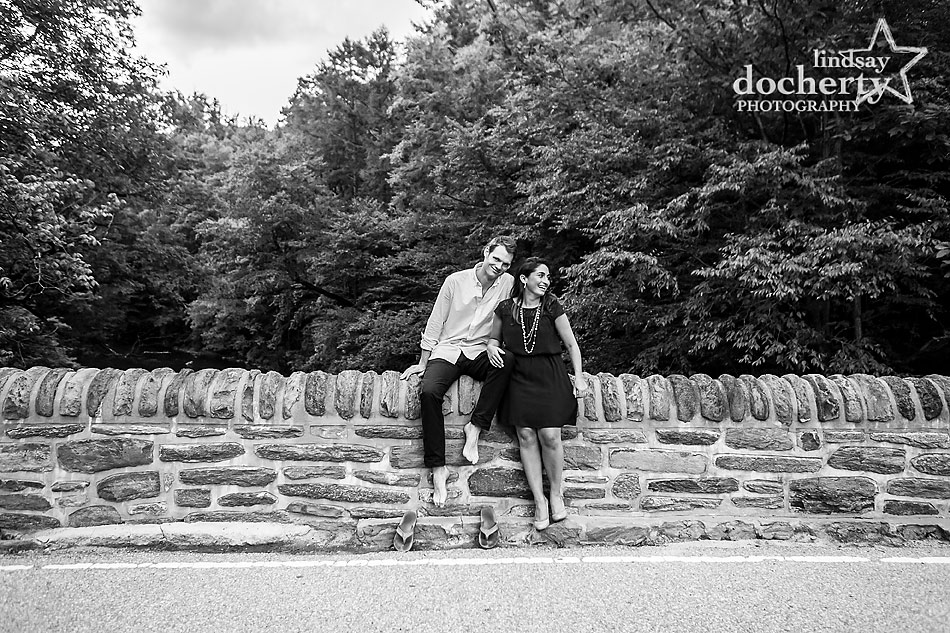 Engagement session by Philadelphia's Wissahickon Creek on the bridge