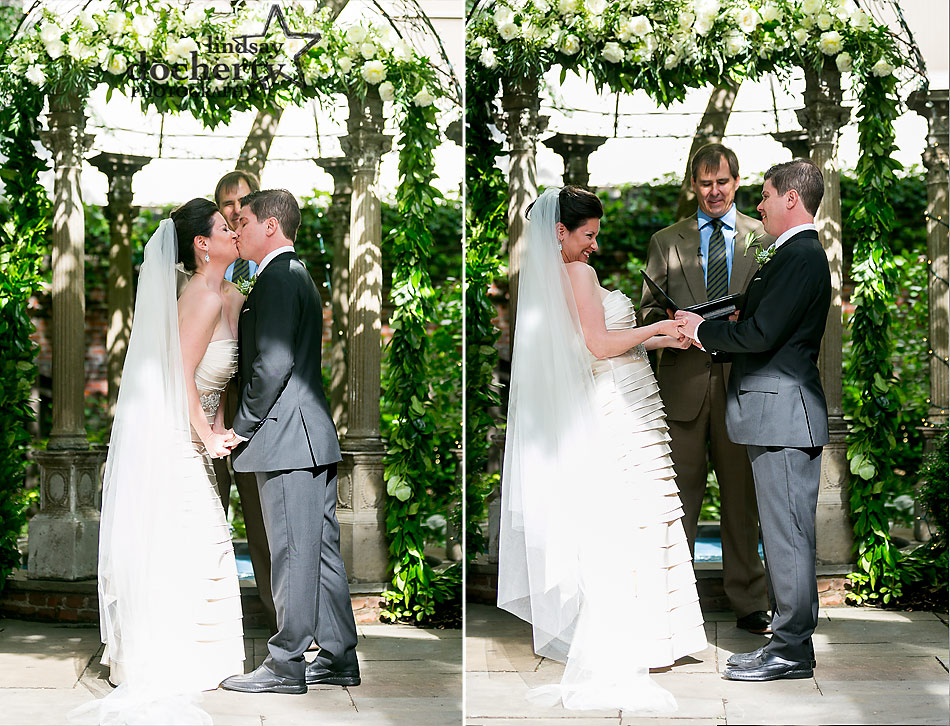 wedding kiss during ceremony at Morris House Hotel in Philadelphia