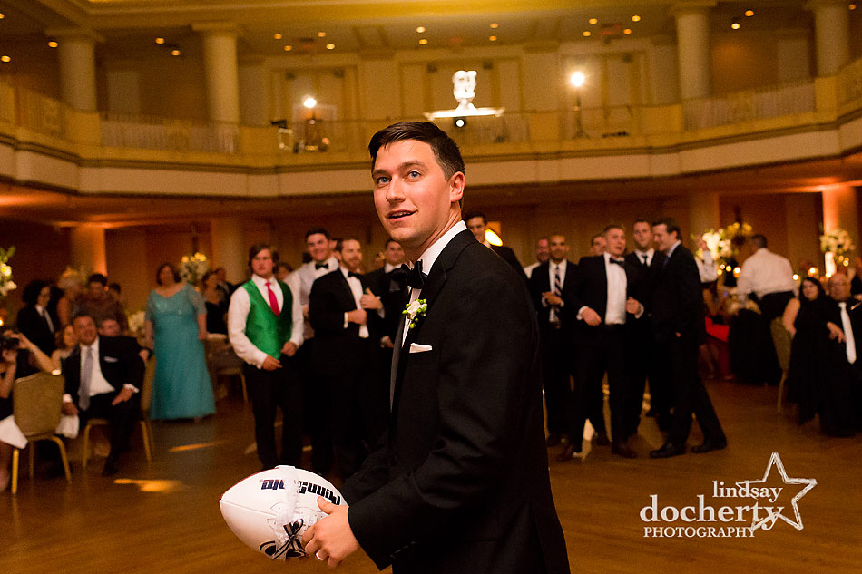 Penn State football garter toss at Philadelphia wedding reception at the Hyatt at the Bellevue grand ballroom