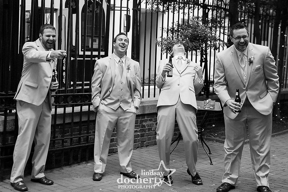 groomsmen laughing at Philadelphia wedding reception at Morris House Hotel