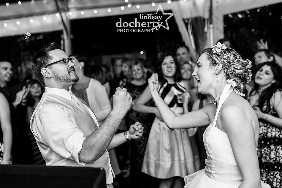 bride and groom rocking out at Philadelphia wedding reception at Morris House Hotel