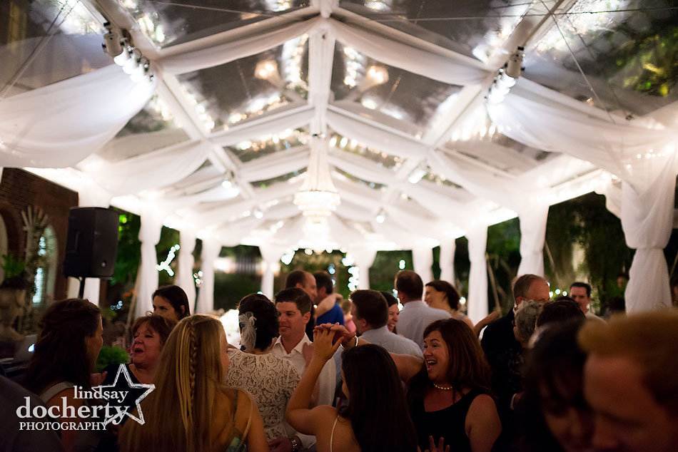 outdoor wedding reception at night at Morris House Hotel in Philadelphia with draping and clear tent