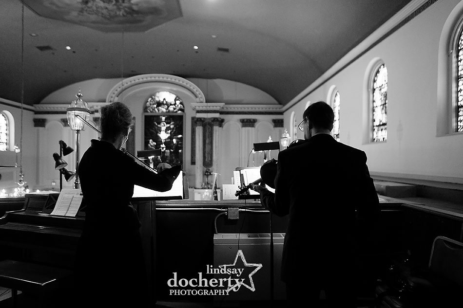 violinists at Catholic wedding ceremony at Old St. Mary's church in Philadelphia