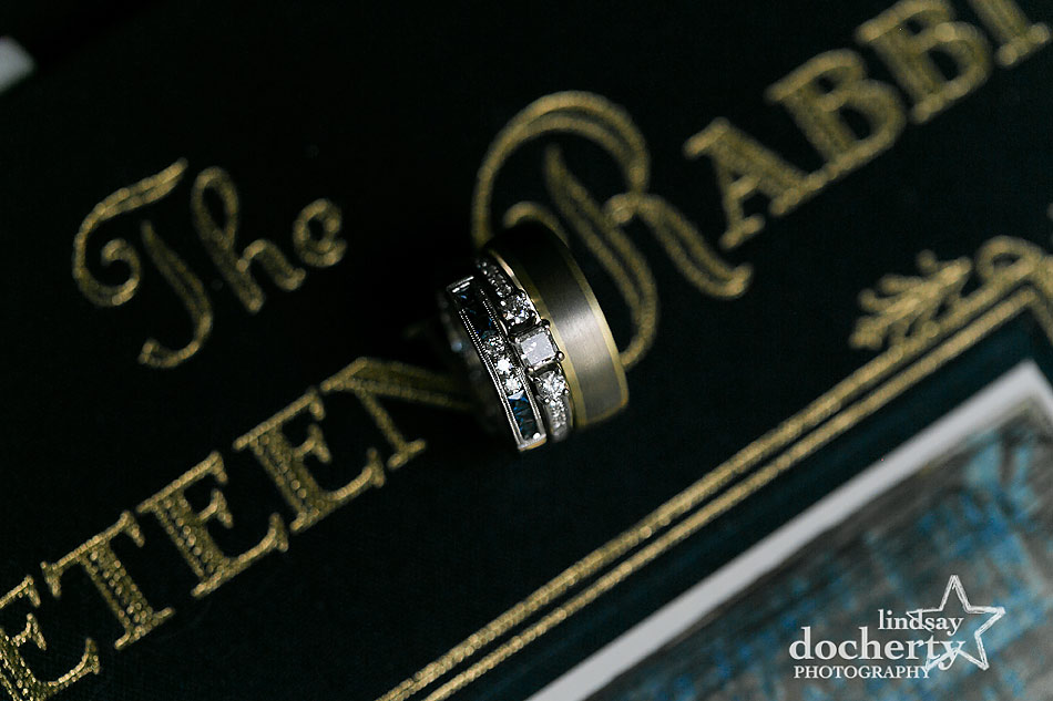 wedding bands and engagement ring on childhood book The Velveteen Rabbit