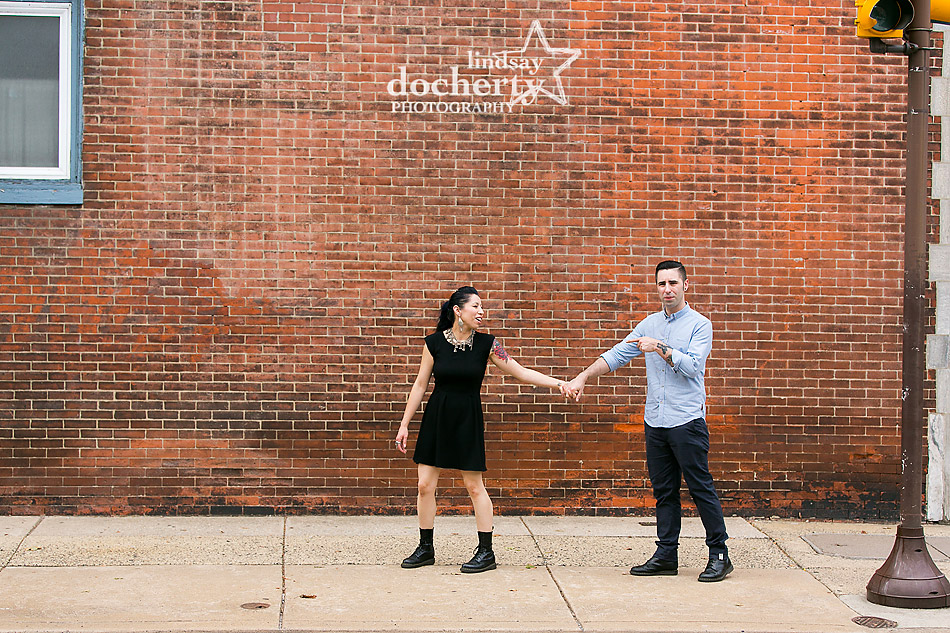alternative-couple-engagement-session-in-Philadelphia-against-bricks