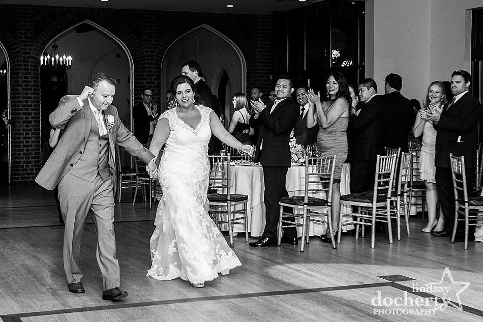 bride and groom enter reception at Aldie Mansion in Doylestown