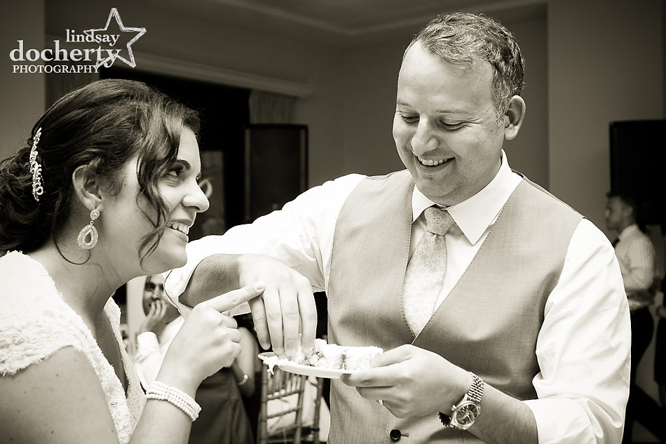 bride and groom feeding cake at Aldie Mansion wedding in Doylestown