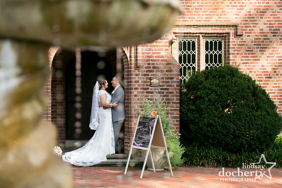 bride and groom picture by fountain at Aldie Mansion wedding in Doylestown