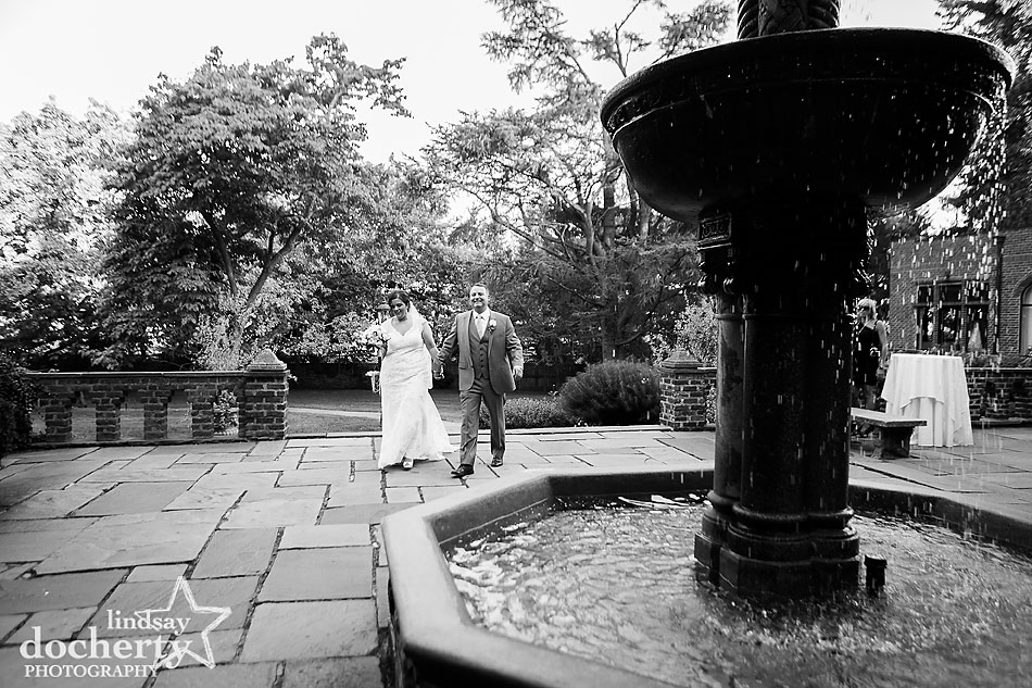 after ceremony bride and groom picture by fountain at Aldie Mansion wedding in Doylestown