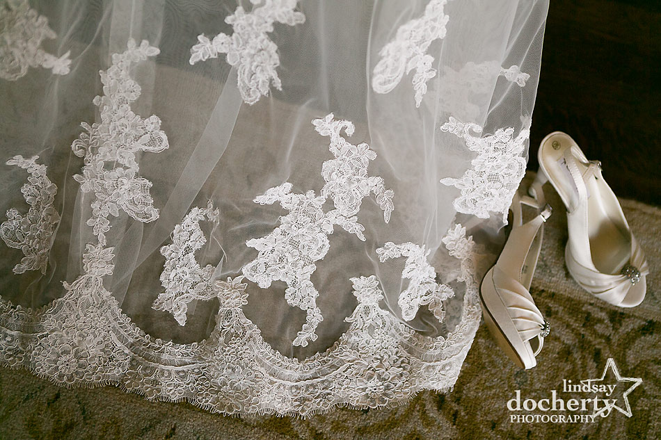 brides lace wedding dress and white shoes at Aldie Mansion wedding in Doylestown