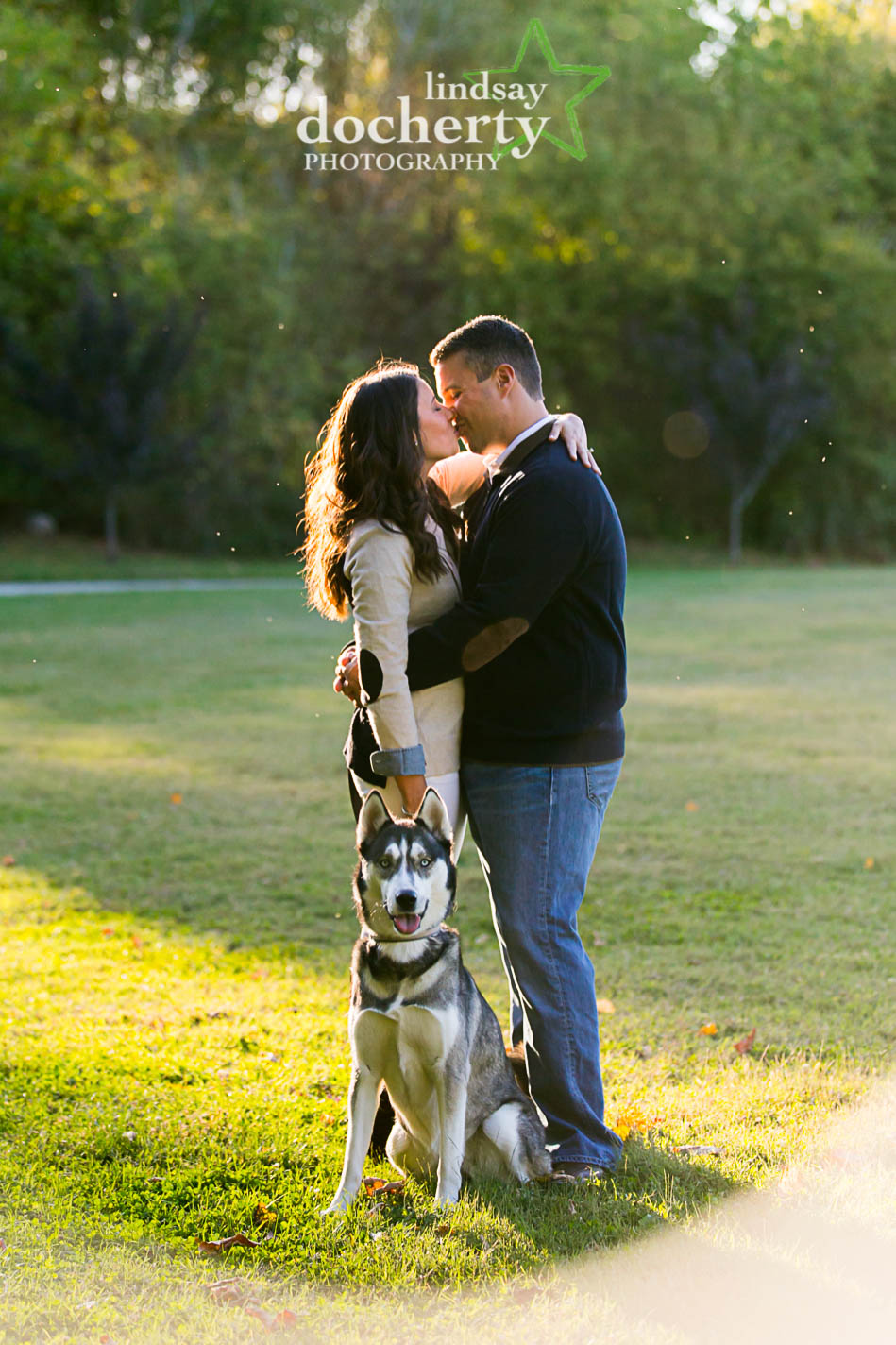 beautiful engagement pictures in park with Siberian husky dog