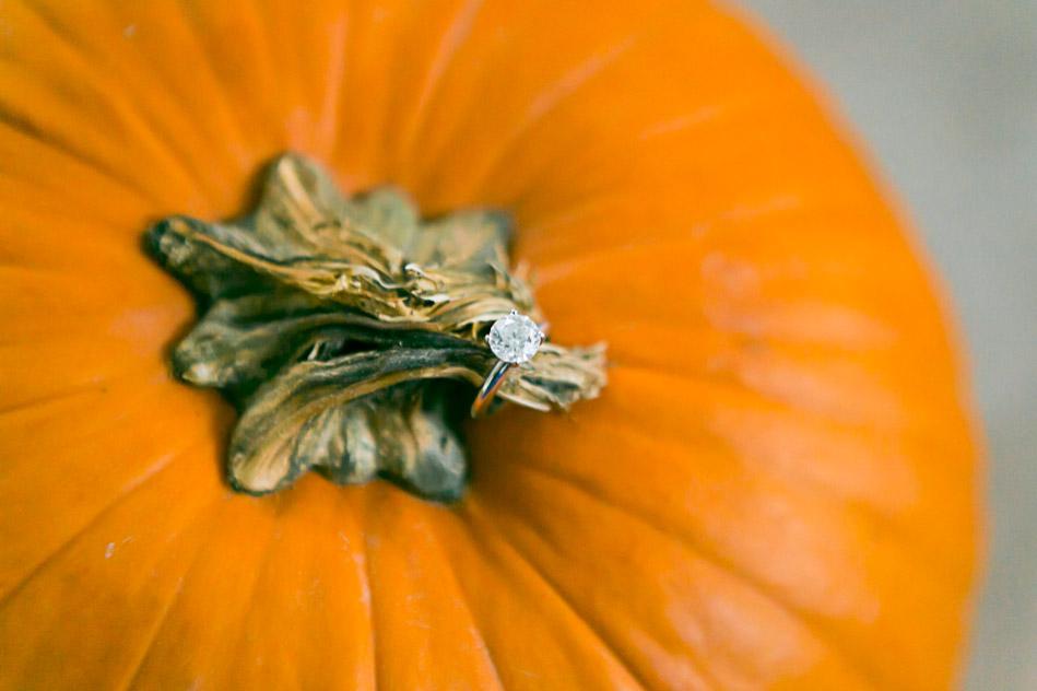 big diamond engagement ring on pumpkin