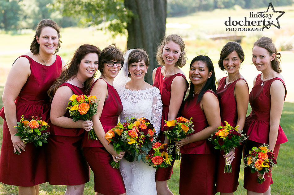 bride and bridemais in red silk peplum dresses at summer wedding at Army Navy Country Club in DC