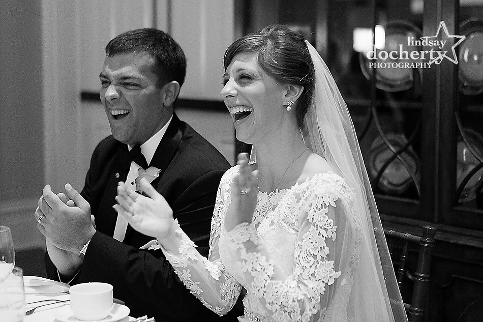 bride and groom laughing during toasts at DC Army Navy Country Club wedding reception