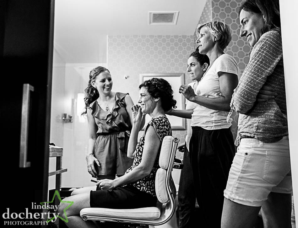 bride getting hair and makeup done at Hotel Palomar in Philadelphia